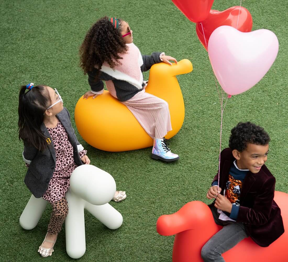 Kids playing with balloons.