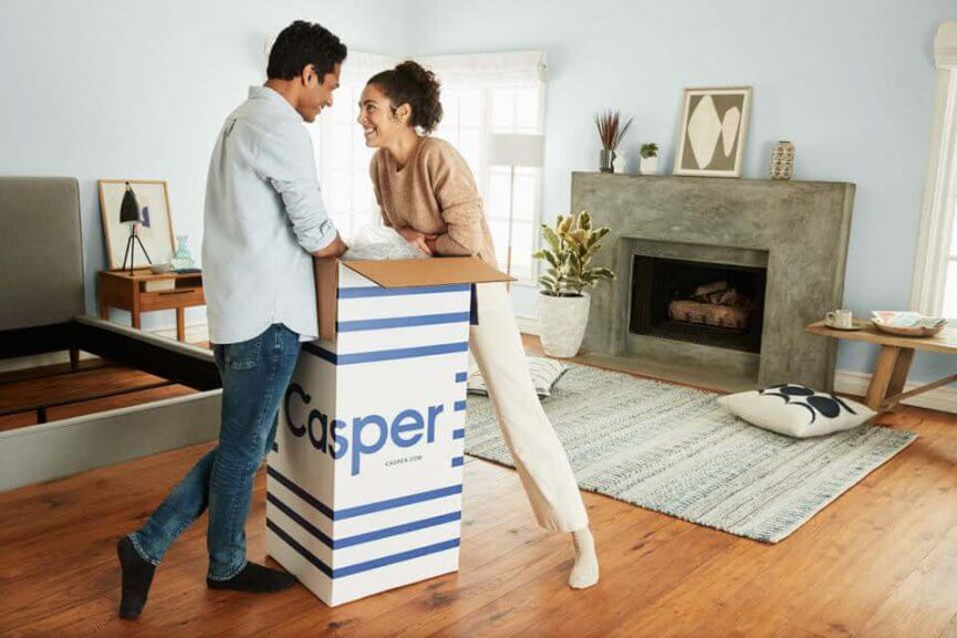 Man and woman with a Casper box