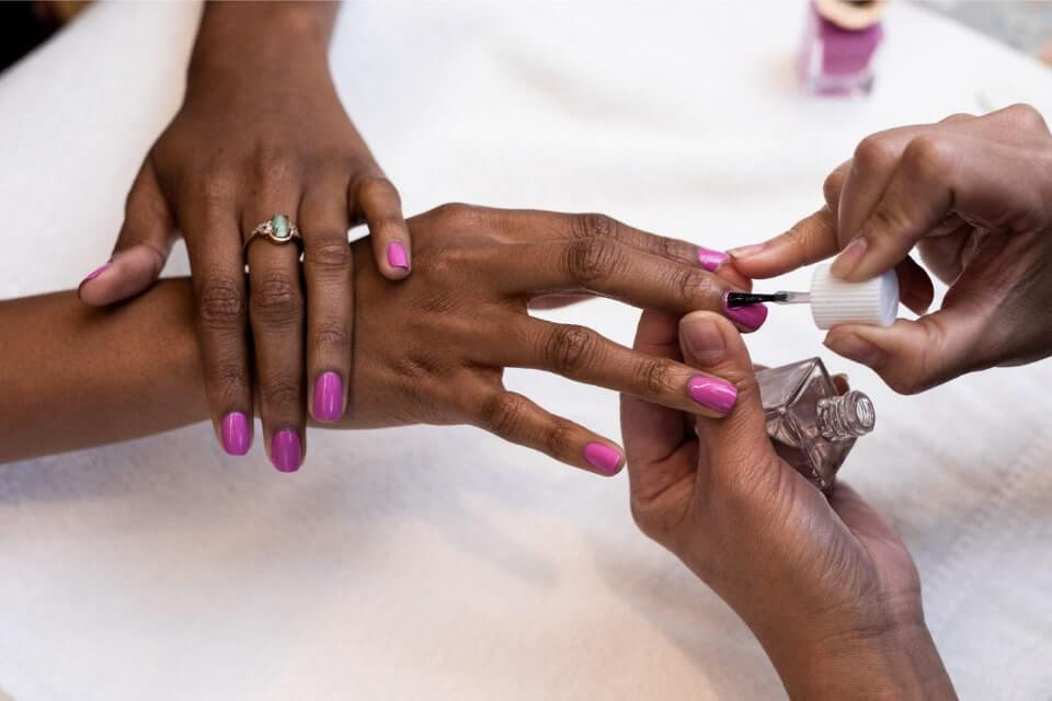 Woman getting nails painted