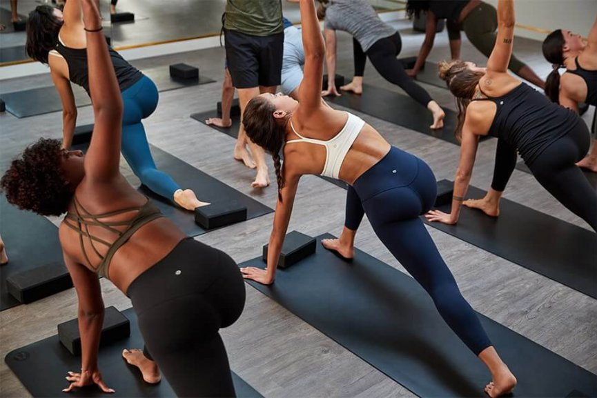 Women doing yoga in lululemon activewear