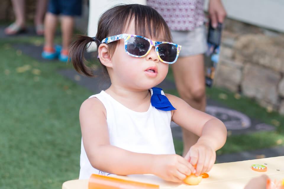 A child wearing sunglasses